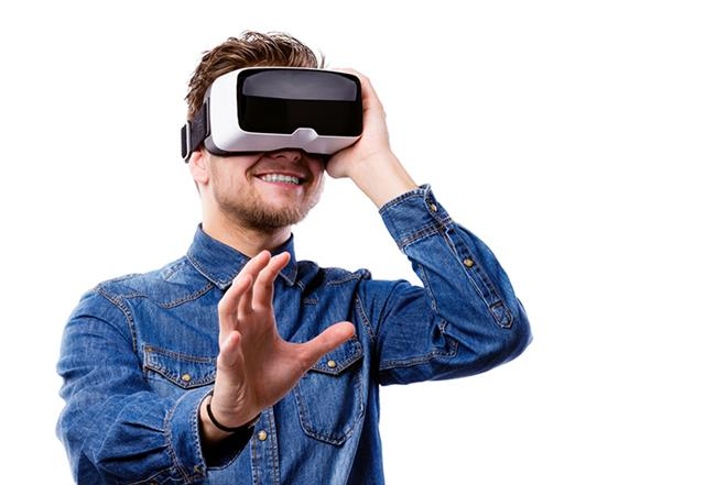 Happy guy wearing virtual reality glasses