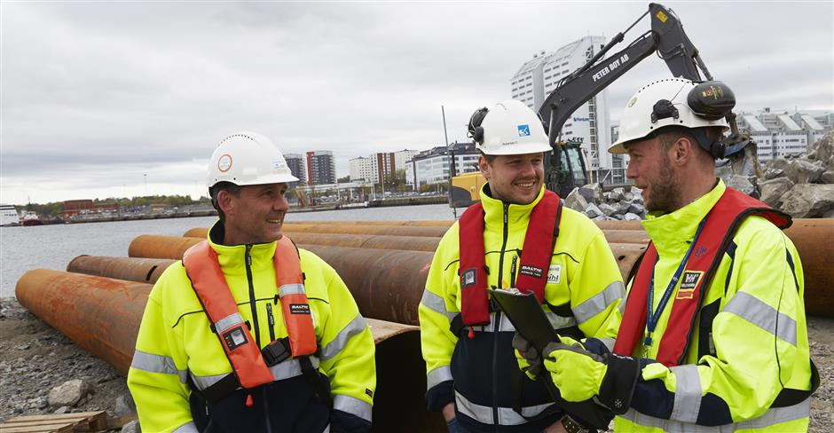 Three builders on site in Värtahamnen