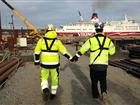 Member of the development project and port employee hand in hand